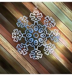 Paper christmas snowflake on a wood EPS 10 vector image
