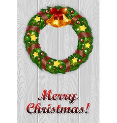 Christmas wreath on a grey wooden background vector