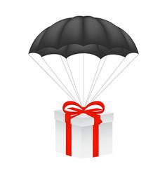 Gift box at black parachute vector
