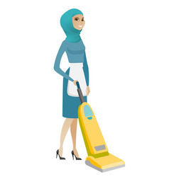 muslim chambermaid cleaning floor with a vacuum vector image
