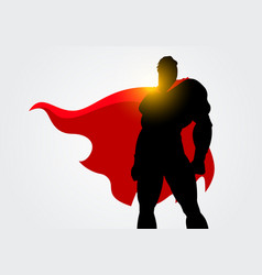 Silhouette of a superhero with red cape posing vector