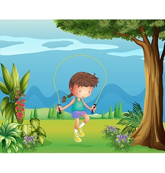 A girl playing jumping rope near the tree vector image vector image