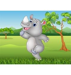 Cartoon funny rhino posing in the jungle vector image
