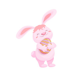 Cute fluffy pink bunny with a painted easter egg vector