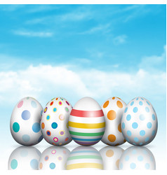 easter eggs on a blue sky background vector image