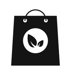 Paper bag with leaves black icon vector image