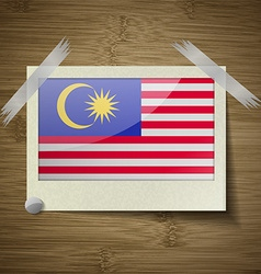 Flags malaysia at frame on wooden texture vector