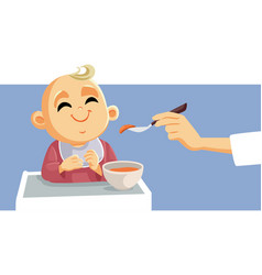 cute little babeing fed using spoon vector image