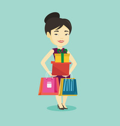 Happy woman holding shopping bags and gift boxes vector