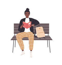 Student studying and reading book outdoors vector