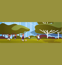 schoolboys playing football elementary school kids vector image