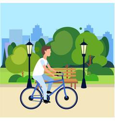 riding bicycle public urban park man cycling vector image