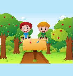 two boys sitting on wooden sign vector image