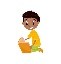cute boy sitting on the floor and reading a book vector image