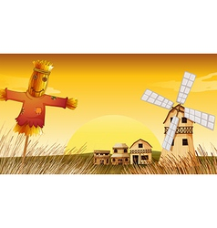 A farm with a scarecrow and a windmill vector image