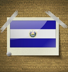 Flags El Salvador at frame on a brick background vector