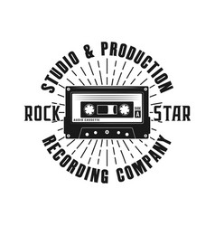 rock music emblem with audio cassette and rays vector image