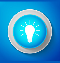 white light bulb icon isolated on blue background vector image