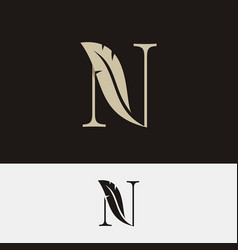 Letter n with feather logo on black and white vector