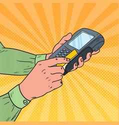 pop art male hands swiping credit card terminal vector image