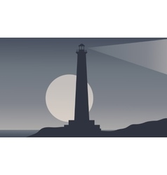 Silhouette lighthouse and moon vector