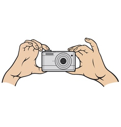 Camera in hands vector image