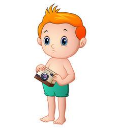 little boy cartoon holding a camera vector image