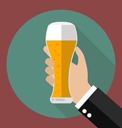 Glass of beer in hand vector