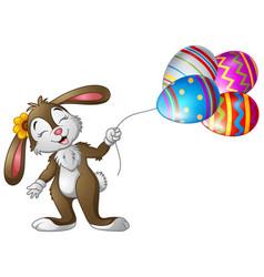 Easter bunny holding easter eggs balloons vector