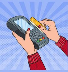 Pop art female hands swiping credit card terminal vector