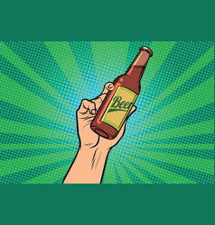 Beer bottle in hand vector