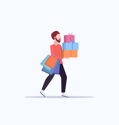 man carrying colorful paper bags and gift boxes vector image