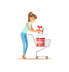 Happy woman in a casual clothes putting a gift box vector