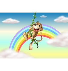 A monkey hanging on a vine plant near the rainbow vector image vector image