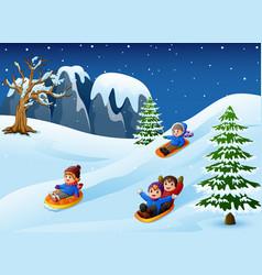 Children sledding in snow downhill vector