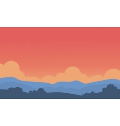 Silhouette of hill and orange sky vector