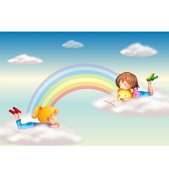 Two girls along the rainbow vector image