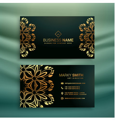 Premium business card with golden floral design vector