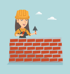 Young caucasian bricklayer building a brick wall vector