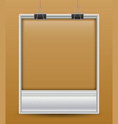 Photo frame with two paper clips vector