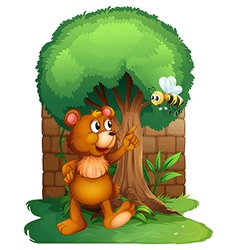 A bear and the bee with a big tree vector image