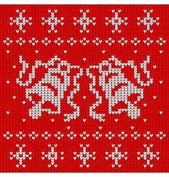 Red knitted sweater with two bells vector