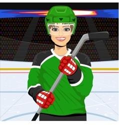Female ice hockey player with an ice hockey stick vector