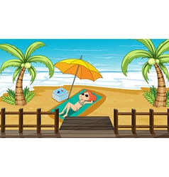 A girl sunbathing at the shore vector image