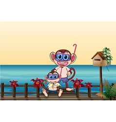 A small and a big monkey at the bridge vector image
