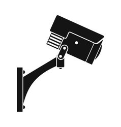 Surveillance camera black icon vector