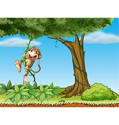 A monkey playing with the vine plant vector image