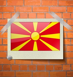Flags Macedonia scotch taped to a red brick wall vector