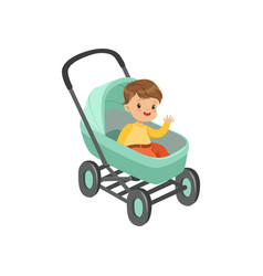 Cute little boy sitting in a turquoise baby pram vector