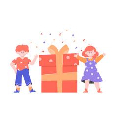 Joyful boy and girl next to a big gift box vector